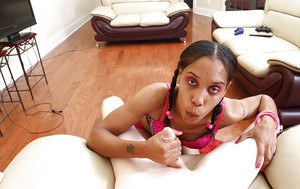 Chippy ebony slut with pigtails performs a sloppy handjob on a white boner