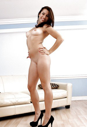 Fuckable brunette with shapely tits undressing and spreading her sexy legs