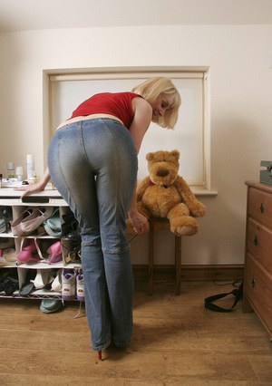Playful mature blonde in blue jeans undressing and exposing her hairy gash