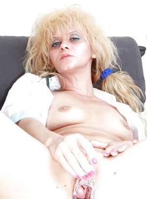Sassy mature nurse stuffing her twat with a vibrator and gyno tools