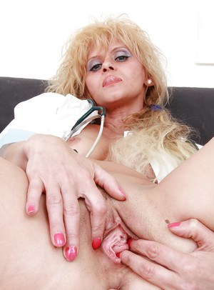 Filthy mature nurse taking off her panties and teasing her gash in close up