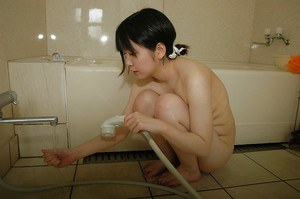 Sassy asian teen taking shower and rubbing her slit in close up