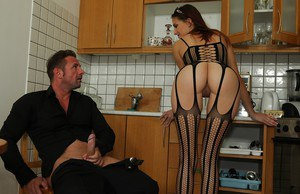 Stunning brunette in sexy nylon outfit performs a proper blowjob on a big dick