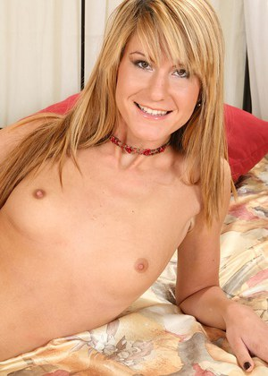 Skinny amateur with pierced clit taking off her lingerie and exposing her vag