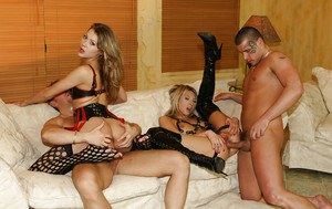 Lustful girls in fetish outfits have a passionate groupsex with hung lads