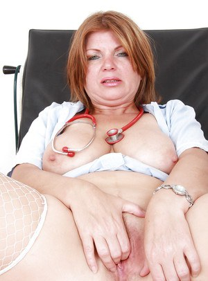 Chubby mature nurse in stockings fingering her gash and tasting her juices