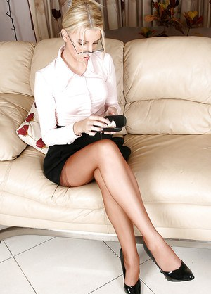 Svelte blondie in glasses and stockings undressing while talking by the phone