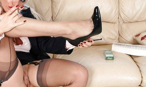 Immensely wooing MILF in stockings smoking and uncovering her big jugs