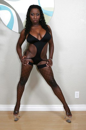 Sassy ebony chick in bikini and fishnet stockings reveals her massive jugs