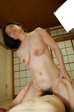 Slutty mature asian lady gives a blowjob and gets her hairy cunt banged tough