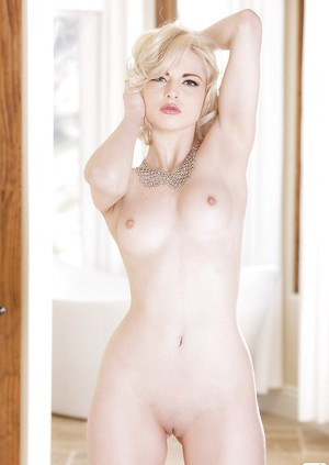 Admirable blonde amateur with pale sking demonstrating her svelte curves