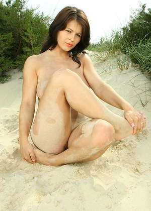 Desirable pretty with massive bosoms taking off her bikini and teasing her slit