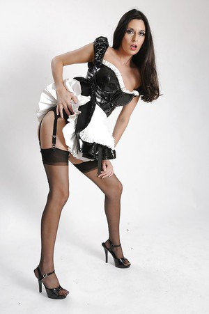 Leggy brunette maid in stockings getting rid of her uniform and lingerie