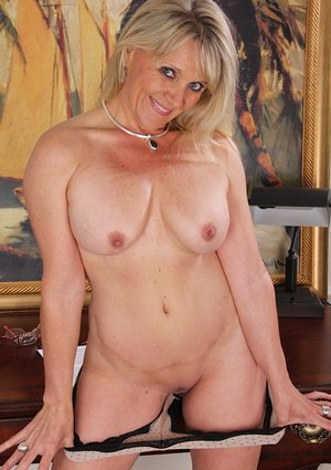 Lusty mature blonde undressing and exposing her juicy twat in close up