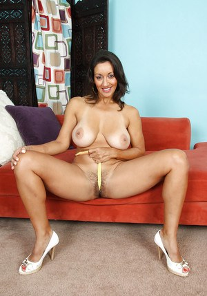Big busted mature vixen taking off her lingerie and brushing her hairy bush