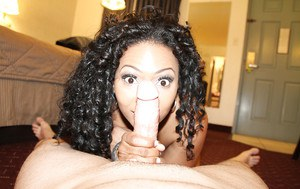 Naughty ebony lady jerking a white dick for a cumshot on her tongue
