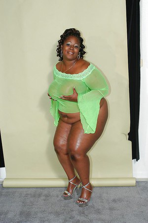 Salacious ebony plumper in high heels uncovering her fatty curves