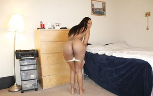 Smiley ebony floosie with sexy ass getting rid of her clothes