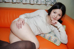 Sassy asian girl in nylon knee socks undresses and has some pussy vibing fun