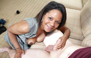 Busty ebony MILF milking a white boner with her hands and mouth