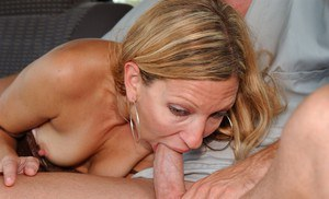Slutty MILF has some cock sucking and pussy fingering fun in the car