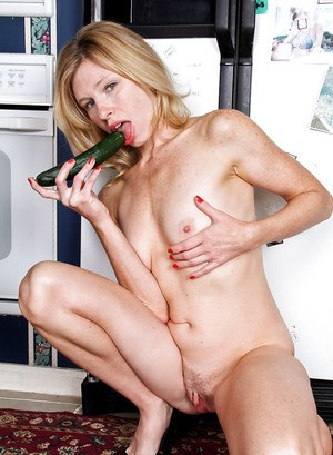 Naughty housewife getting horny and masturbating her cunt with a carrot