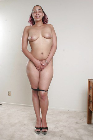 Smiley ebony lassie getting naked and showing off her fatty booty