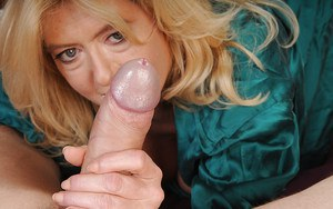 Sassy mature blonde milking a thick dick with her hands and huge fatty tits
