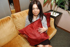 Naughty asian MILF with massive melons getting rid of her clothes