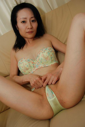 Shy asian MILF with tiny tits stripping down and vibing her hairy slit