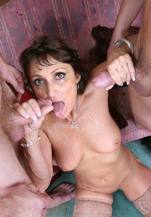 Slutty MILF gets completely glazed with cum after fervent FMM groupsex