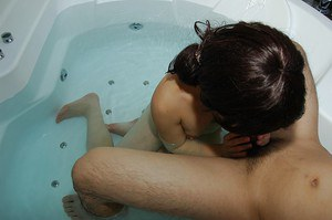 Shy asian lassie gives a soapy hand and a sensual blowjob