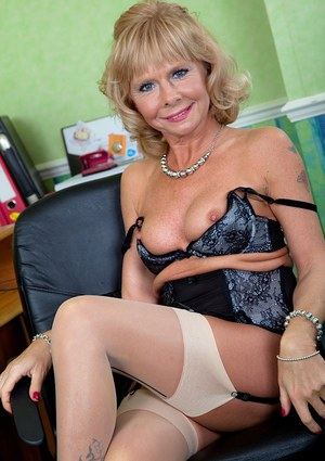 Smiley mature blonde in nylons undresses and bends over to expose her twat