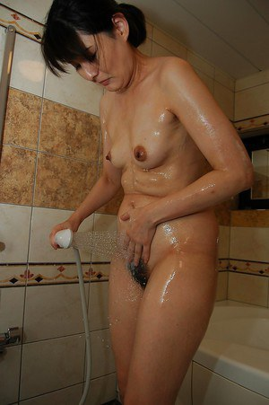 Naughty asian MILF with bushy gash and small tits taking shower