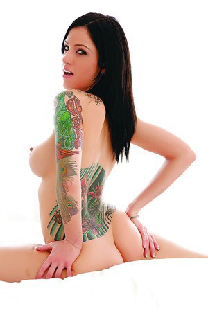 Tattooed hottie with round perky tits poses wearing only knee socks