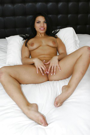 Bosomy latina taking off  her undies and spreading her legs on the bed