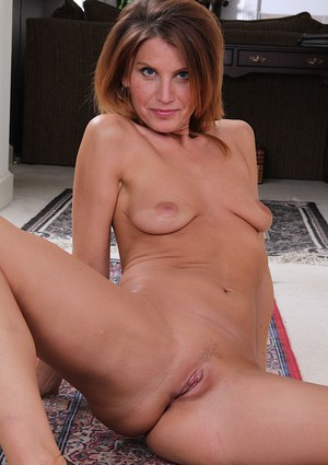 Smiley MILF with slim body undressing and spreading her lower lips