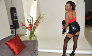 Seductive ebony sugar in nylons slipping off her provocative outfit