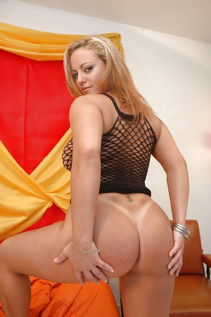 Sassy latina in fishnet dress uncovering her gorgeous curves