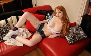 Nasty redhead cutie with shapely tits and shaved pussy stripping down