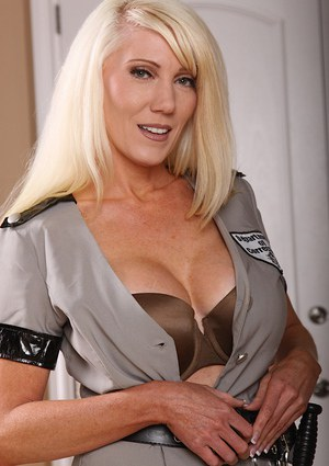 Lusty mature blonde vixen in black boots getting rid of her sexy uniform