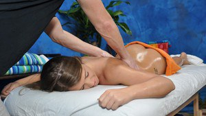 Slutty oiled up teen gets fucked and facialized on the massage table