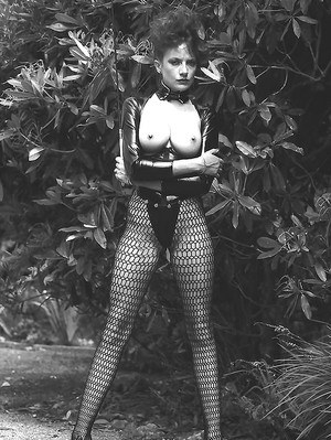 Leggy lady in fetish outfit exposing her boobs in vintage photo set