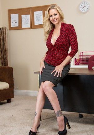 Tempting blonde office lady getting nude and teasing her slit