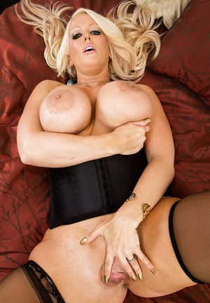 Curvaceous blonde MILF in stockings undressing and teasing her gash