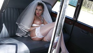Sassy bride revealing her ample melons and shaved pussy outdoor