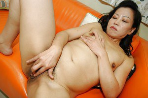 Chippy asian MILF strips down and has some pussy vibing fun