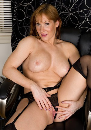 Top-heavy playful MILF in stockings undressing and exposing her gash