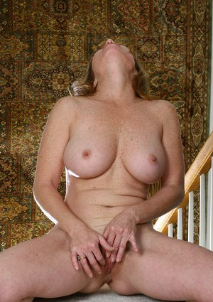 Smiley MILF with huge jugs undressing and exposing her juicy gash