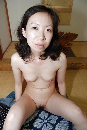 Shy asian MILF strips down and has some pussy fingering and vibing fun